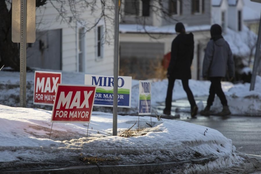 Campaign signs for Mayor Miro Weinberger and one of his challengers Max Tracy fill the patch of grass inside the roundabout intersecting Shelburne road and South Willard St. Feb. 5.