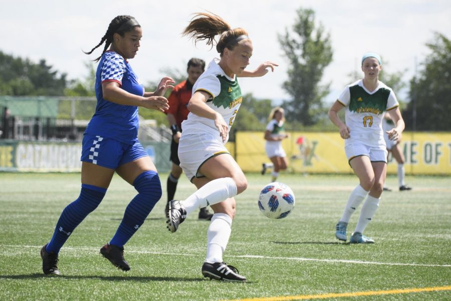 UVM Senior Angie Salvi gets control of the ball during a home game against American University. Salvi plays midfield for the Catamounts.