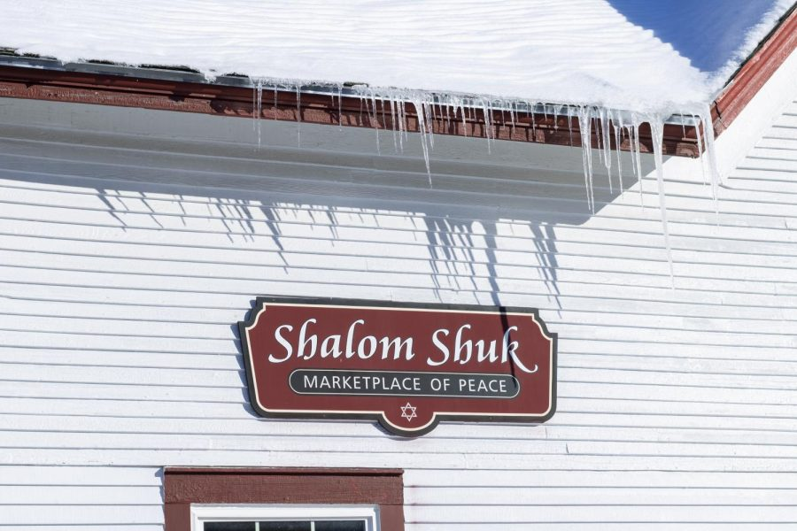A sign outside of Shalom Shuck welcomes visitors as a marketplace of peace Feb. 4. Shalom Shuk states it is dedicated to serving the local community and dedicated to helping new Americans and the underprivileged.