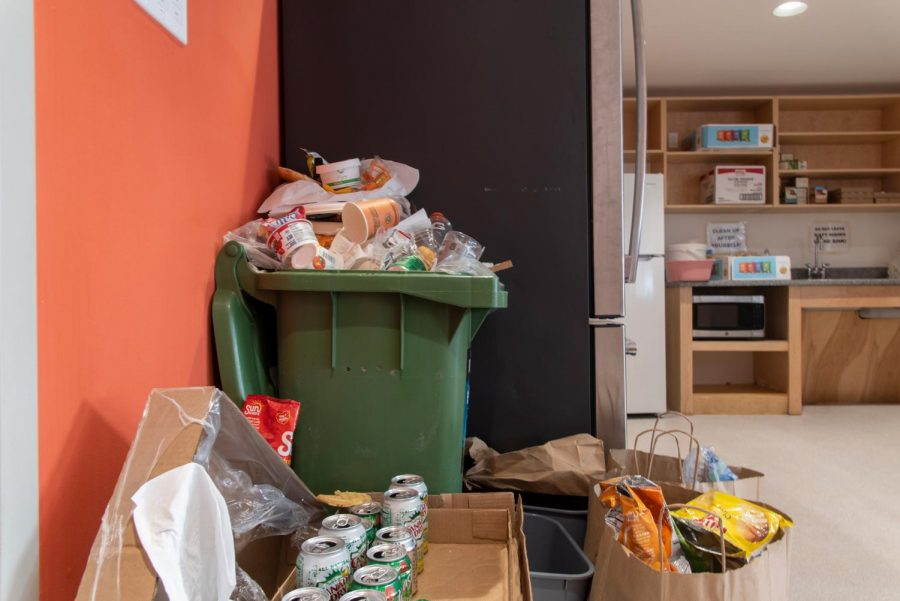 Food waste and containers pile up in recycling and trash bins inside the Slade Hall kitchen. Trash pick-ups were not coordinated regularly causing an overflow in the bins.