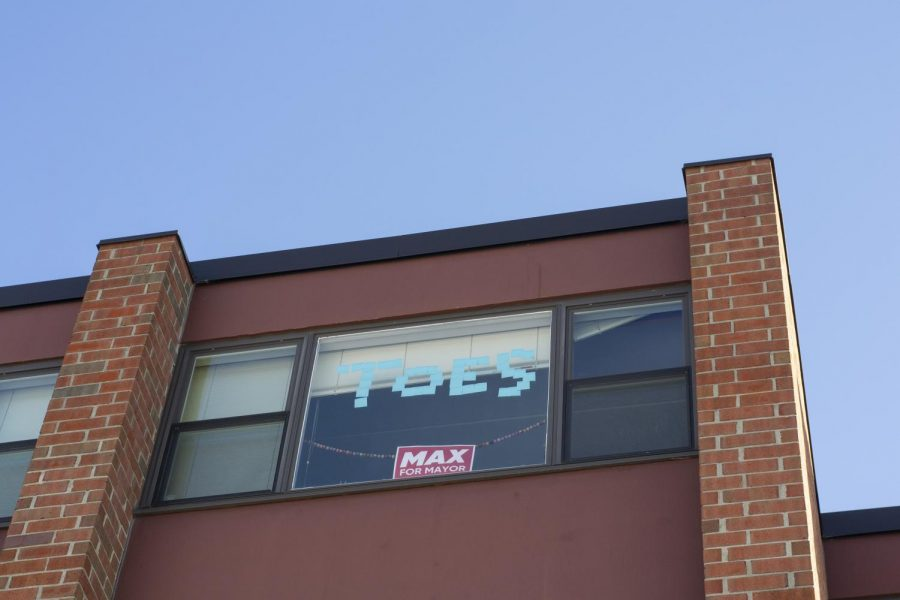 A Max Tracy campaign sign is displayed in a dorm window inside of the Living and Learning dorms Feb. 12.