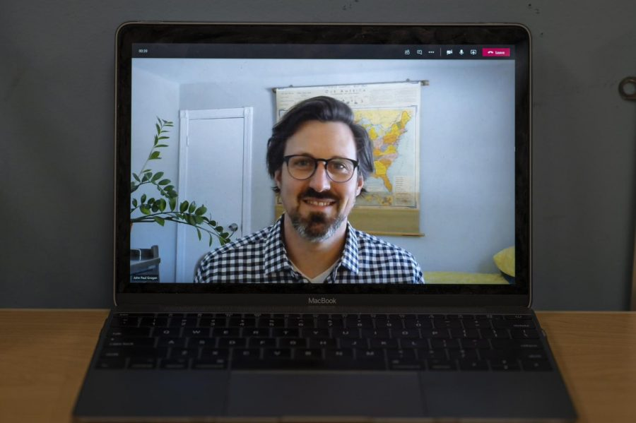 John Paul Grogan, the Director of Health and Outreach for the Center for Health and Wellbeing and the interim Director of the Counseling and Psychiatry Services team appears on a Macbook screen through a Microsoft Teams call Feb. 4.