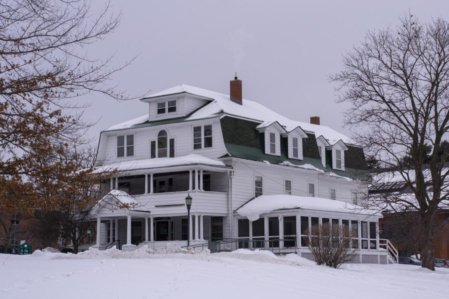 Trinity Cottages, students' dorms on Trinity Campus, are covered in snow Feb.19. Students can be seen inside the building from the sidewalk.