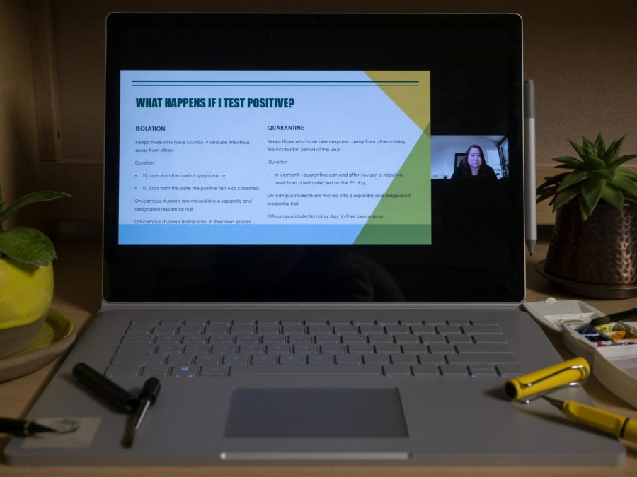 A laptop displays a slide from the UVM Strong slideshow explaining what will happen to a student if they test positive for COVID-19 Feb. 11.