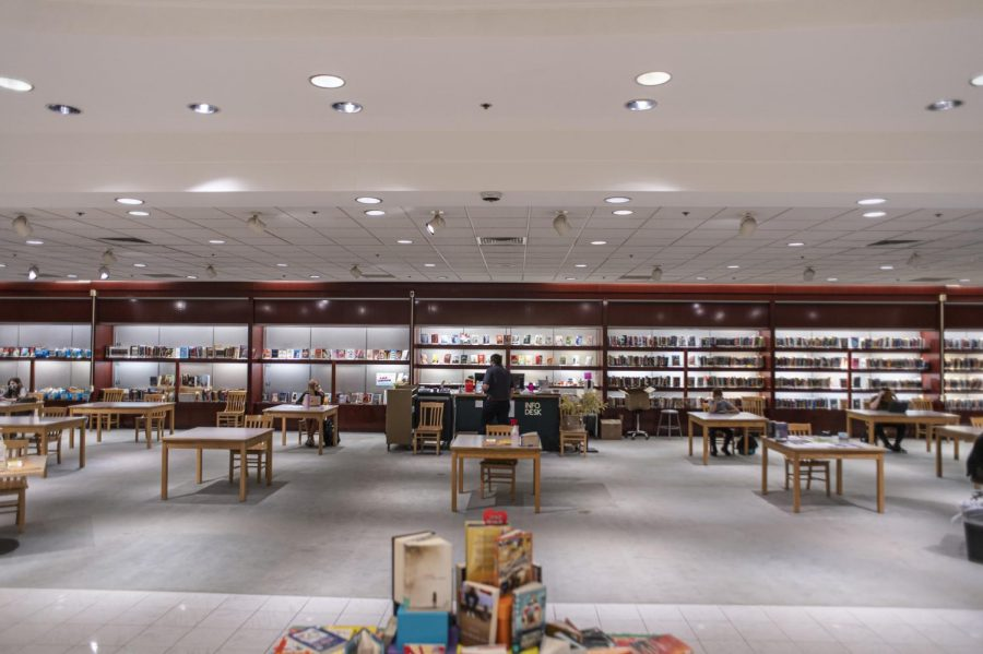 The library is lit up inside former display cases March 16.