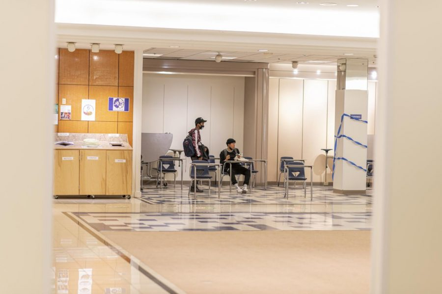 Students sit in the study hall area after the last class of the day is let out March 16.