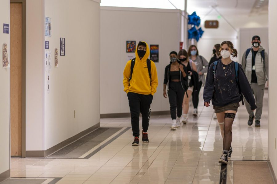 Students walk in the hallway together socially distanced and with masks on March 16.