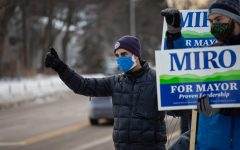 "The now four-term Burlington Mayor Miro Weinberger stands on North Ave during a ""honk and wave"" with his supporters Feb. 19. As cars passed by they honked in support."