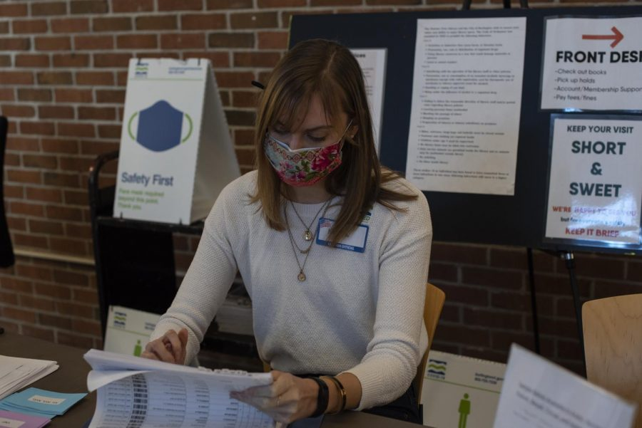 UVM Senior Kayla Downs works at the check-in table for the Ward 8 polling station March 2.