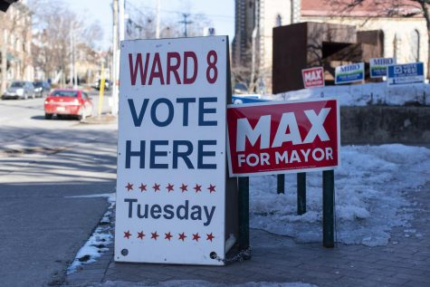 A Ward 8 sandwich board sign stands outside the Fletcher Free Library March 2.
