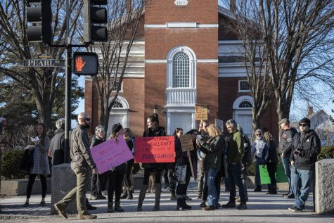 Members of Vermonters Against Unconstitutional Lockdowns and Tyranny, also known as VAULT, gather on Church street for an anti-mask flash mob that began at 5:30 p.m. March 20. The flashmob met at 1 Church street and proceeded to walk down towards City Hall.