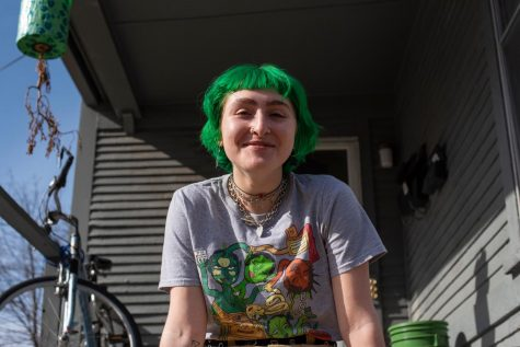 Senior Brooke Katz sits on the porch of their apartment on Colchester street March 3.