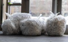 Garbage bags full of tissues sit outside of UVMs COVID testing center March 4.