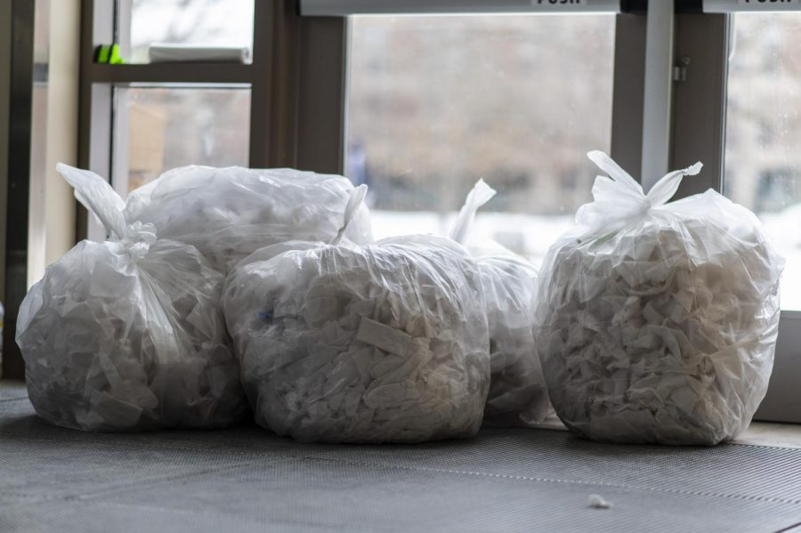 Garbage bags full of tissues sit outside of UVM's COVID testing center March 4.