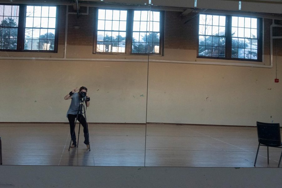 Cynic staff photographer Mary Mclellan poses for a self-portrait inside the dance studio of Mann Hall.