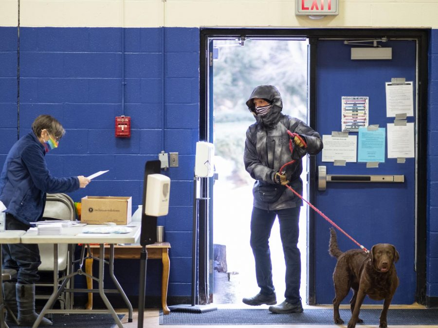 Burlington residents walk in and out of the Mater Christi School to vote during Town Meeting Day March 2.