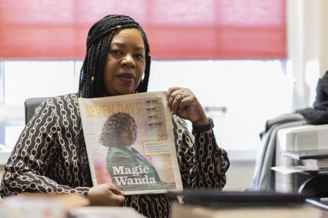 Wanda Heading-Grant, vice president for diversity, equity and inclusion, sits in her office in the Waterman building holding up a story written about her by Seven Days. Grant says she is extremely proud of this story.