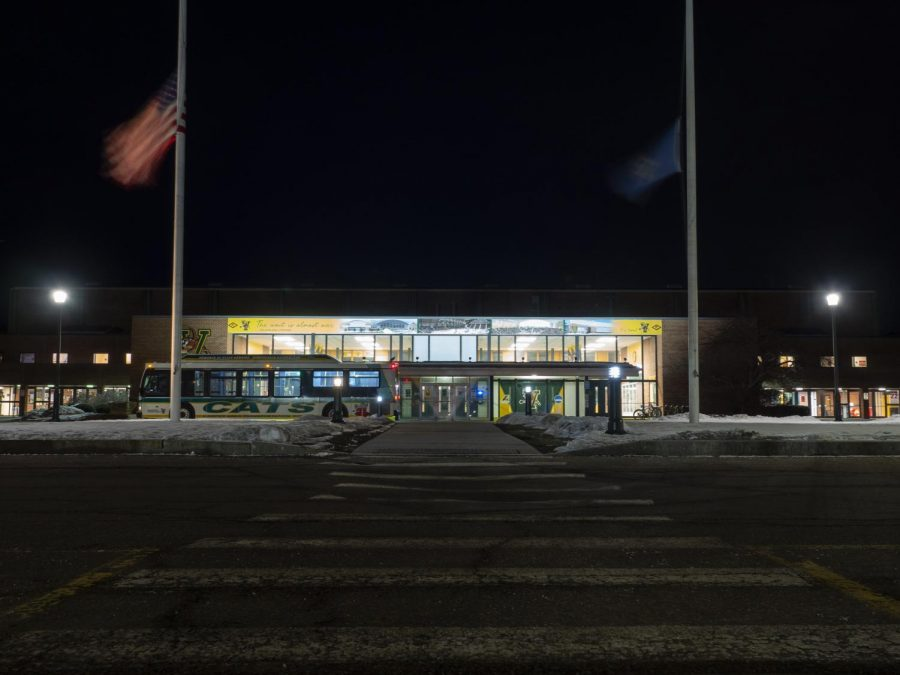 The U.S. and Vermont state flag wave in the wind at half-mast outside Patrick Gymnasium on Athletics Campus March 4.