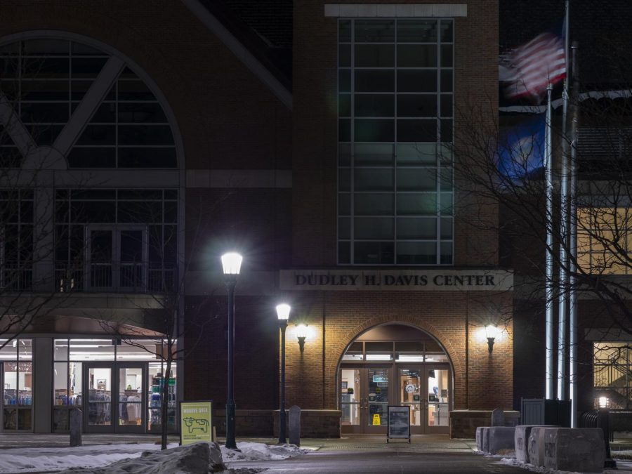 The U.S. and Vermont state flag waves in the wind in front of the Davis Center March 3.