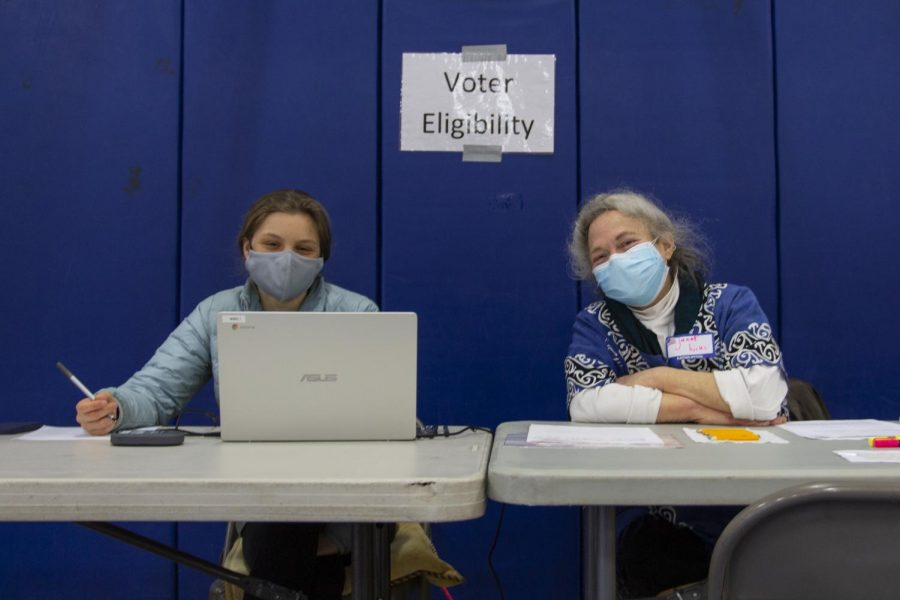 Rebecca Cunningham, Burlington High School Senior and Ward 1 poll volunteer sits next to Ward 1 poll volunteer Janet Hicks inside the Mater Christi School March 2.