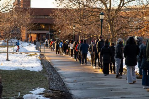 Students line up in the COVID testing line March 1. At 5:00 one end of the line started near Aiken and the other started past the Royal Tyler Theatre.