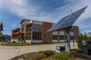 A solar panel stands in front of the George D. Aiken Center April 6. The Aiken Center is certified Platinum in Leadership in Energy and Environmental Design (LEED) granted by the U.S. Green Building Council.
