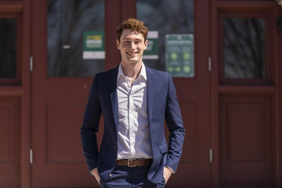 Junior Sam Pasqualoni stands outside Williams Hall April 3. Pasqualoni won the presidential election for SGA April 1 as a write-in candidate.