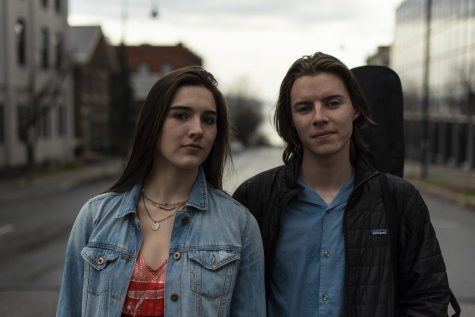 Nullhegan's Emma Downie and Ben Collins, both juniors, stand on College street April 11.