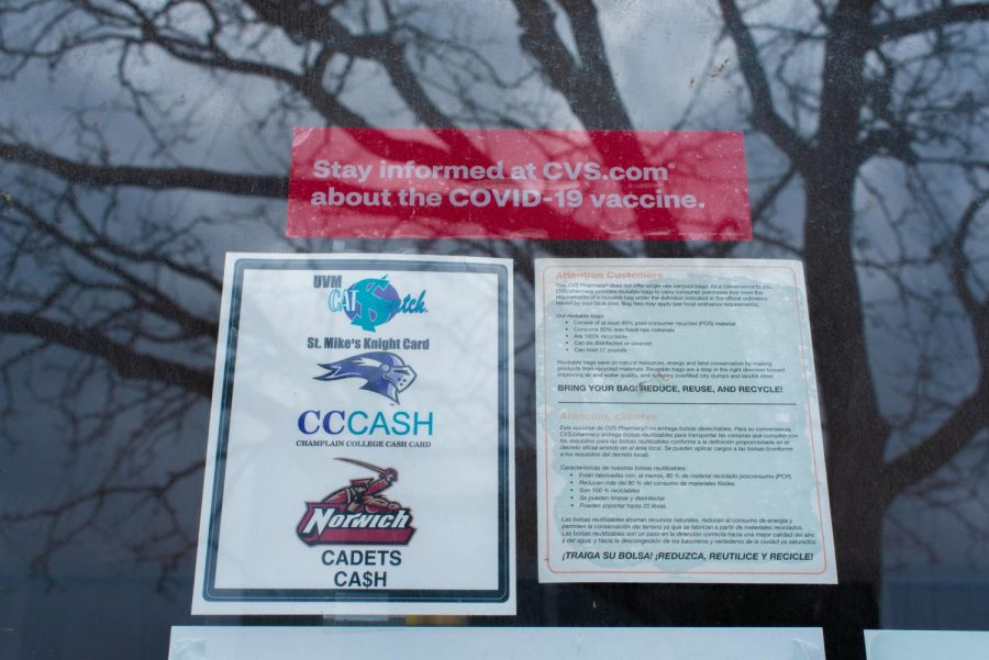 A window sticker informing CVS patrons on how to register for the COVID-19 vaccine is displayed on the Church street CVS April 17.