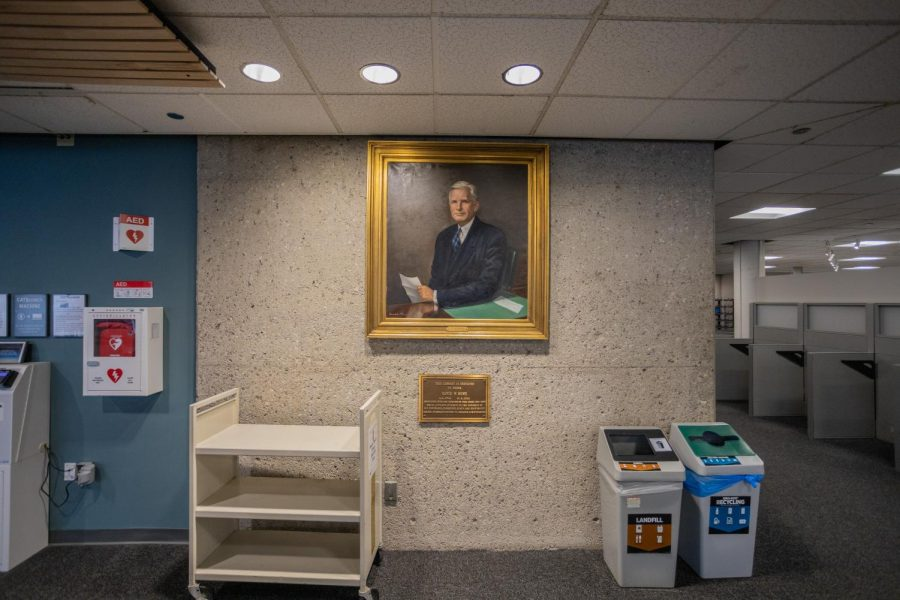 A portrait of David Howe hangs in the Howe Library April 21. A matching portrait of Guy Bailey used to hang beside Howe's but is no longer there.