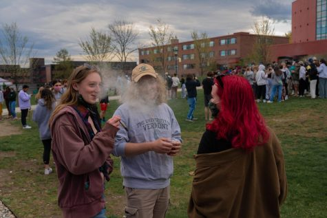 Three students stand smoking joints on the Redstone green April 20.
