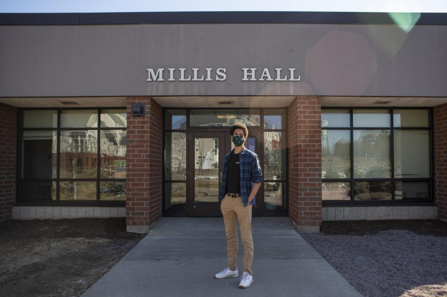 Sophomore Miles Mccallum stands in front of Harris-Millis Hall where he works as an RA.
