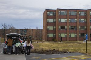Students pack up their dorm belongings outside Harris-Millis Hall March 18.