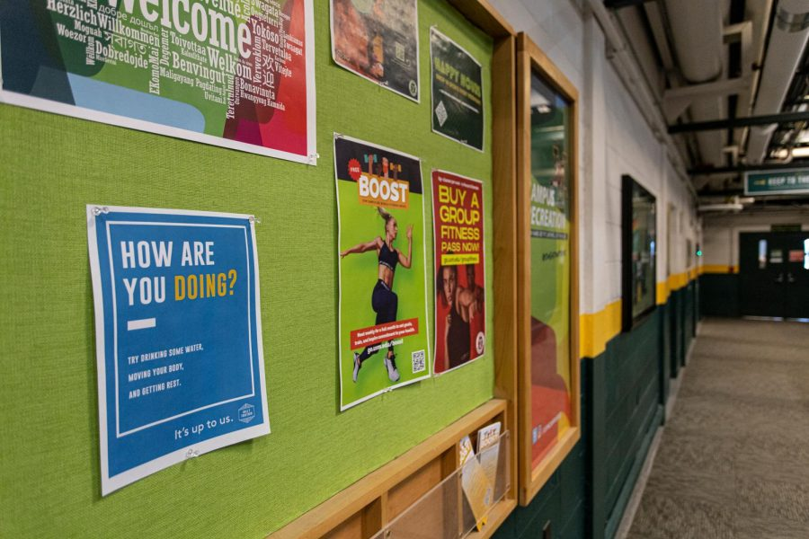 A UVM STRONG sign is pinned to a bulletin board outside the lower track in the Patrick Gym.