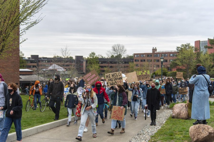 With junior Athena Hendrick leading the crowd the protesters began flowing out of the Redstone Green to begin their walk out May 3.