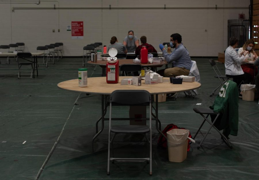 A table with vaccination supplies sits empty May 2. After check-in students waited in folding chairs before they were called to get their Johnson and Johnson vaccine.