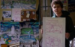 Junior Charlie Piper holds up two of his drawings May 9.