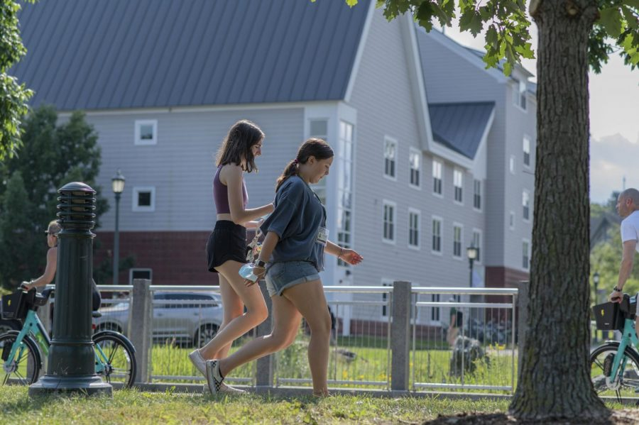 UVM students walk around campus without face masks Aug. 27.