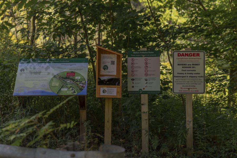 Signs warn visitors of dangerous waters at Bolton Potholes.