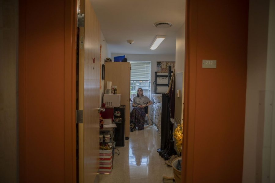 First-year Grace Antis sits in their dorm room before the beginning of the fall semester.