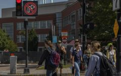 A group of students cross at the intersection on Main Street by University Heights the morning of Sept. 8.