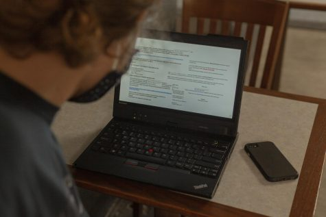 A collection of recent email scams appear on a laptop screen Sept. 1.