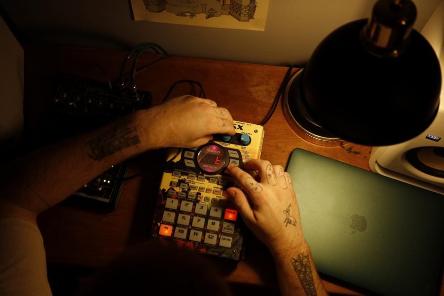Chaz Krouse '21 aka DJ Greyhound sits in his home studio Sept. 9.