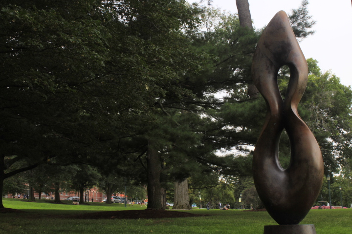 A sculpture stands on the Waterman Green.