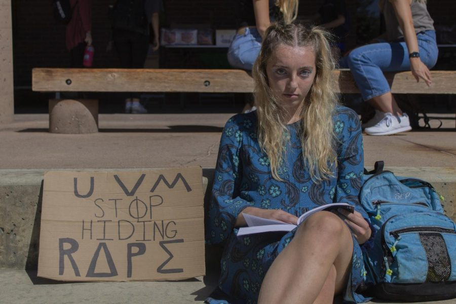 Junior Syd Partin sits on the steps of the Howe Library with her sign the morning of Sept. 16.