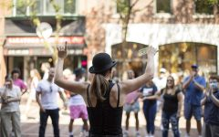 Alyx the Magician wraps up a performance on Church Street.