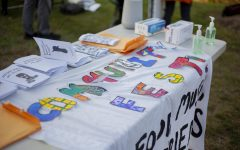 """Letters pinned to a table spell out """"CommunityFest"""" and pamphlets are laid out to be passed out on the Athletic campus green Oct. 1."""