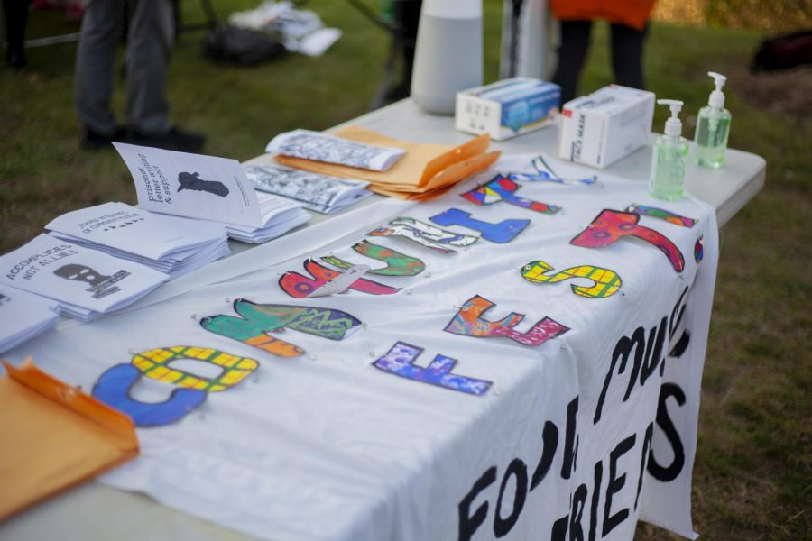 Letters+pinned+to+a+table+spell+out+%E2%80%9CCommunityFest%E2%80%9D+and+pamphlets+are+laid+out+to+be+passed+out+on+the+Athletic+campus+green+Oct.+1.