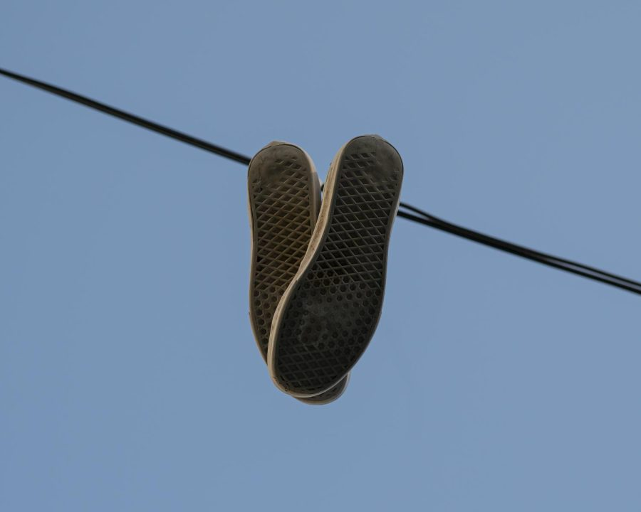 A pair of shoes hand from a telephone wire on Loomis Street June 15.